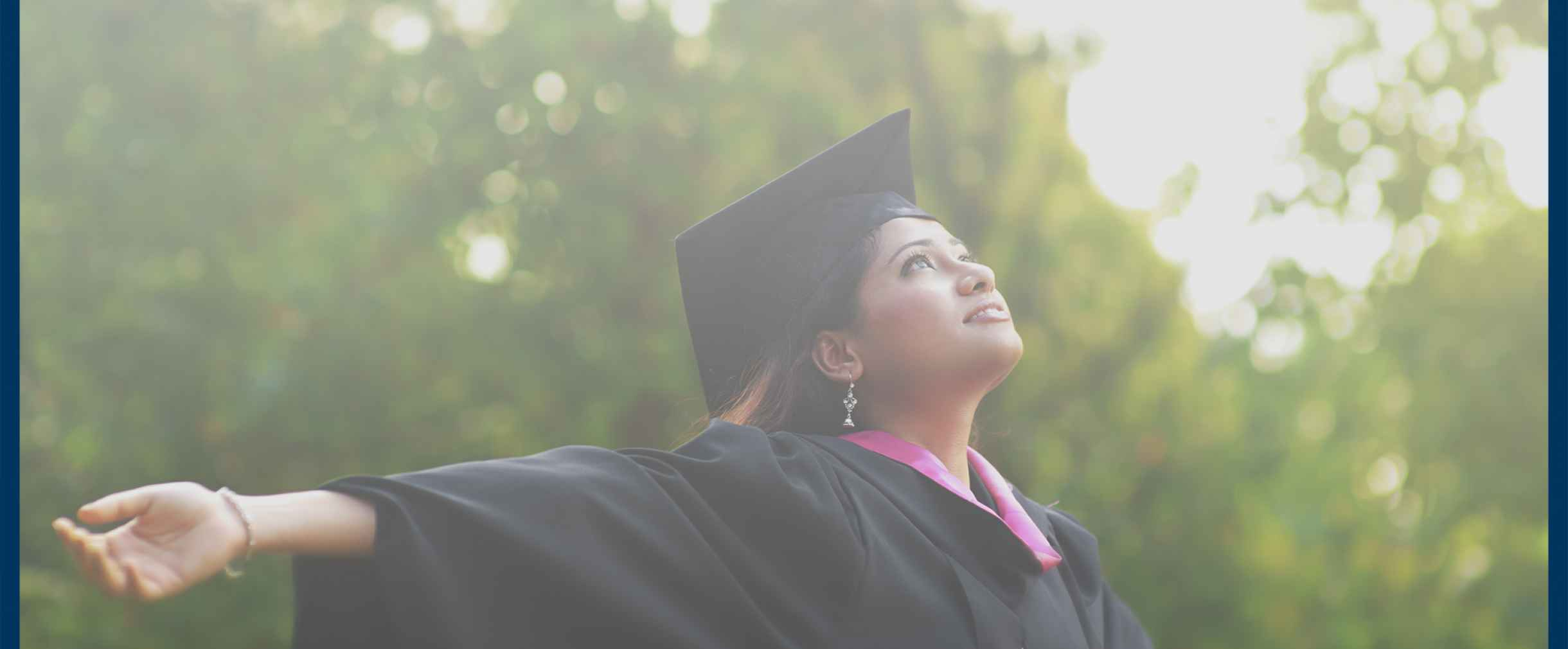 Young woman wearing a graduation gown