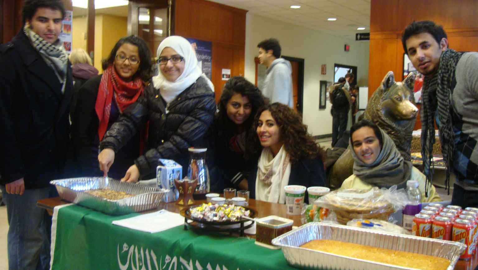 international students sharing homemade foods for cultural gathering