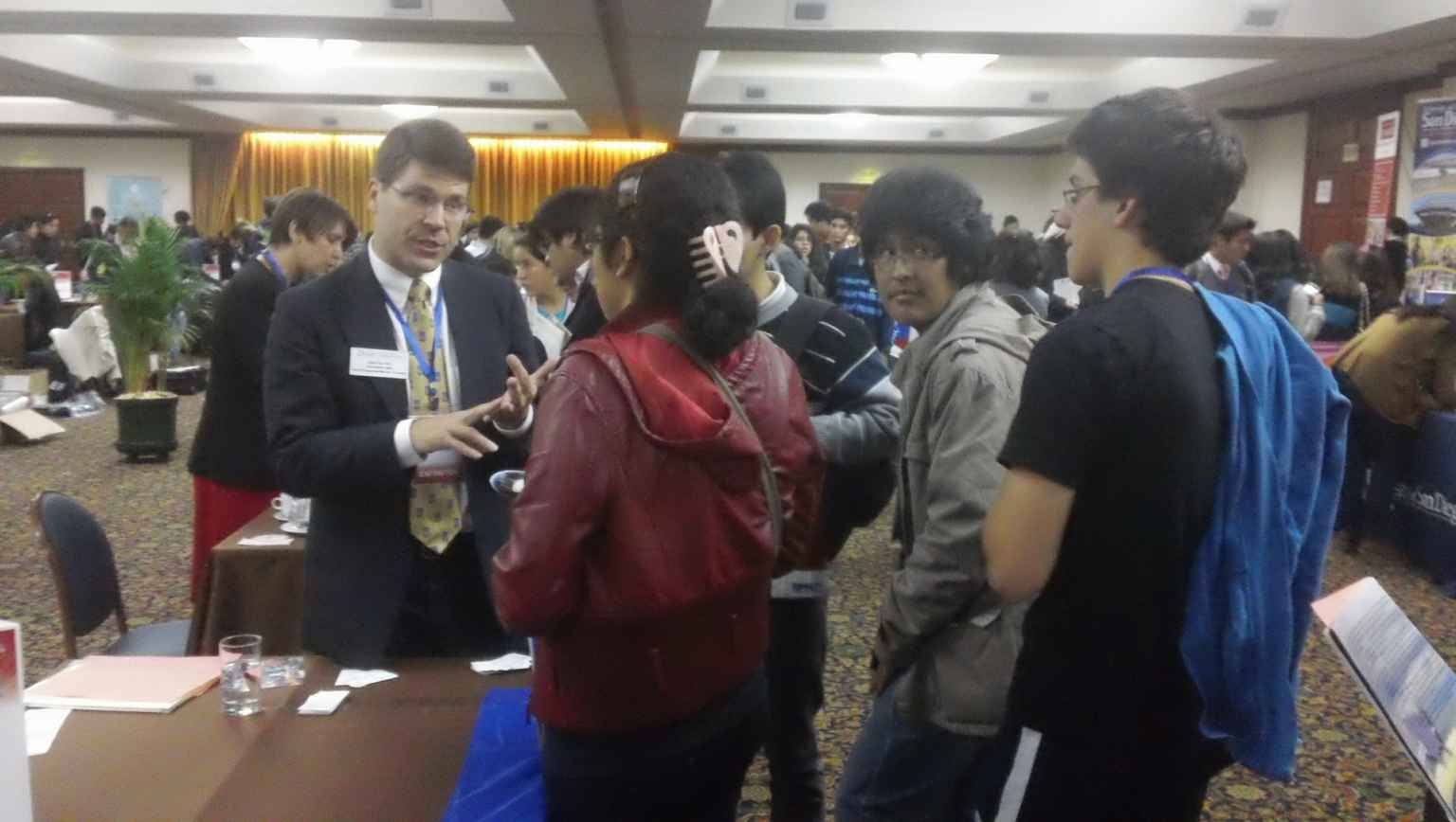 International students at US college fairs meeting with advisors and representatives