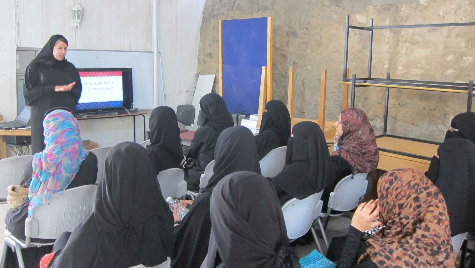 Female students in Sanna, Yemen gather for an Education USA information session