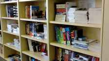 Bookshelf full of EducationUSA resources (books)