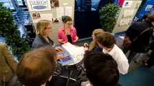 EducationUSA Adviser Molly Roza speaks with students
