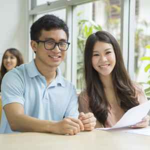 International students filling out visa forms to study in the USA